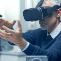 Photo of a man wearing a virtual reality headset