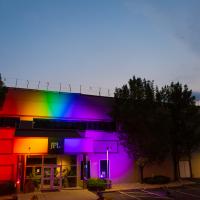 Photo of the JPL building, illuminated by rainbow lights