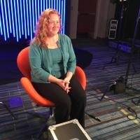 Erika Wharton from Unum sits in chair for interview